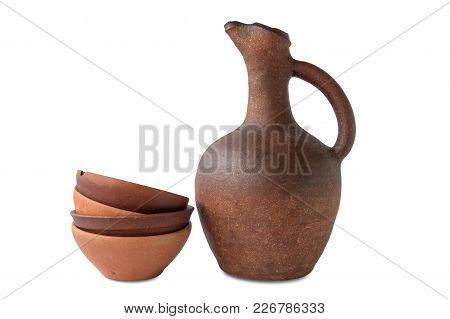 A Wine Jug And Set Of Clay Terracotta Cups On A White Background, Isolated