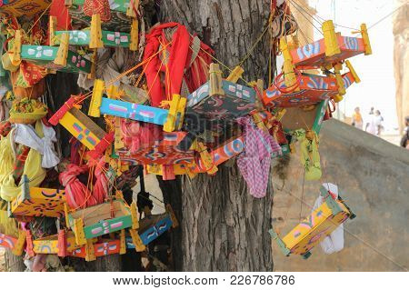 A Tree In India, According To Believe Giving Children. The Tree Of Desires Is Decorated With Baby Be