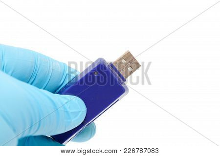 Hand In Blue Glove Holding Usb Drive On White Background