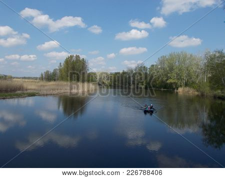 A View Of The Rates On A Fine Clear Day, The Reflection Of Trees In The Water, The Countryside. Ukra