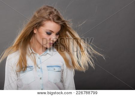 Haircare, Beauty, Hairstyling Concept. Portrait Of Young Attractive Blonde Woman Wearing White Shirt