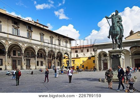 Florence, Italy - September 17, 2017: Piazza Della Santissima Annunziata; A Busy Paved Square Nearby