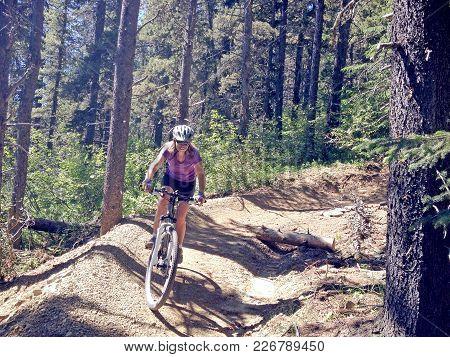 Picture Of A Female Mountain Biker In Bragg Creek, Alberta, Canada.