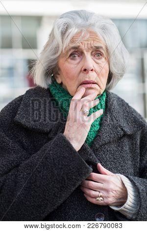 Worried Senior Woman Looking Lost On Street