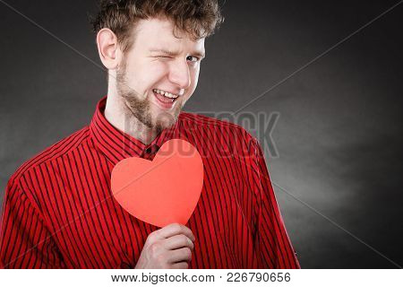 Feelings Affection Happiness Concept. Cheerful Man Holding Heart. Youthful Energetic Smiling Male Ho