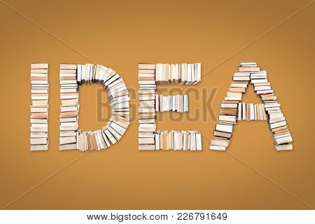 IDEA word formed from books, shot from above on yellow background