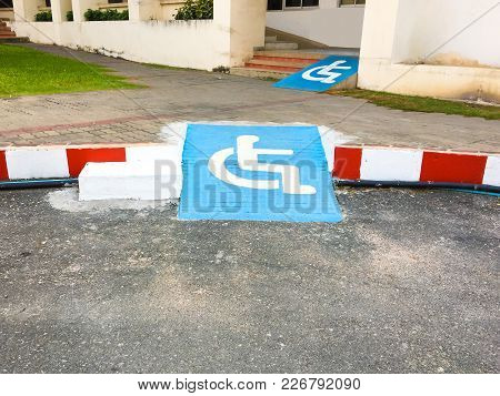 Disabled Symbol Pathway For Wheelchair Ramp In Place Background Texture.