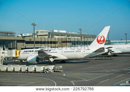 Narita, Japan 6 Aprill 2017 Japan Airline aircraft docking at Tokyo NArita Airport.  Narita is a hub