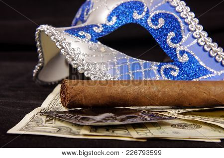 Prostitution Concept: Luxury Cigar, Money, Condoms And Seduction Domino Mask