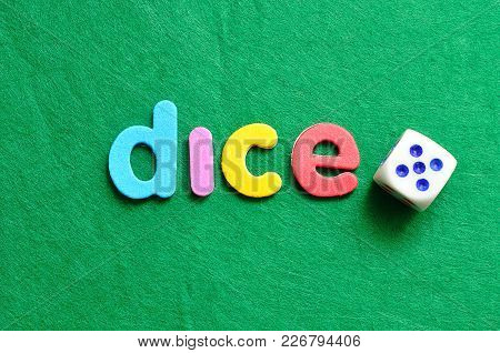 The Word Dice Displayed With A Dice On A Green Background