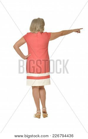 Emotional Elderly Woman Showing Something On A White Background