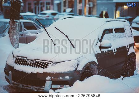 Cars Are Parked Along The Roads Covered In Snow
