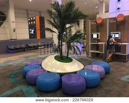 Kuala Lumpur, Malaysia - December 31, 2017 - Chairs Arranged Surrounding A Tree In The Waiting Loung