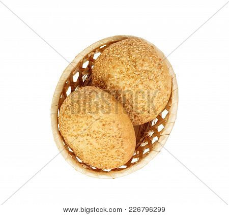 Tasty Basket With Bun Bread On White Background Isolated. Delicious Assorted Bagels. Top View.