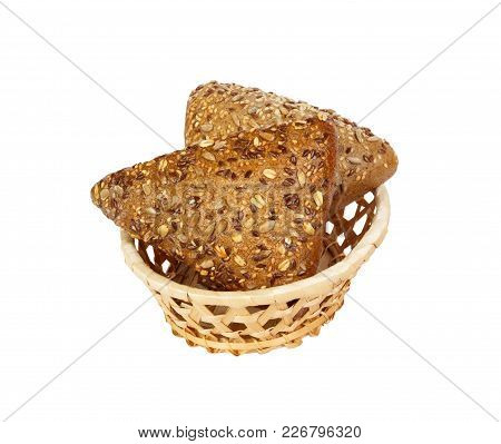 Closeup Of Rye Bread With Flax Seeds On Basket Isolated On White Background.