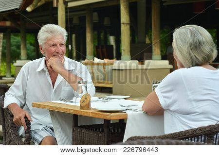 Amusing Happy Smiling Old Couple At Cafe Table
