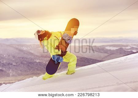 Happy Lady Snowboarder Is Having Fun With Snowboard Like Playing Guitar