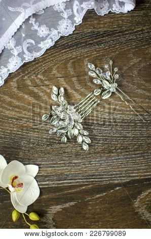 White Bridal  Lace Lingerie On The Brown Wooden Background. Fasion Woman Panties And Accessories