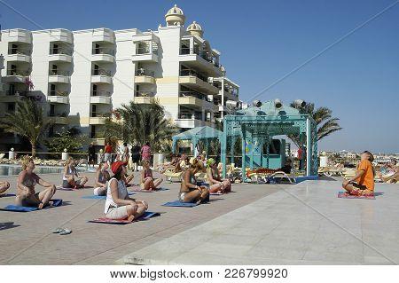 Hurghada, Egypt - November 9, 2006: Sun Rise Hotel. Tourists On The Animation Yoga