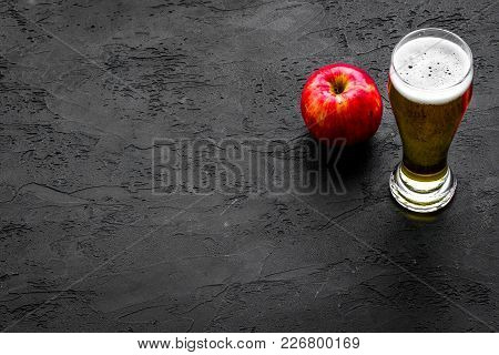 Apple Cider Poured Into Glass. Black Background Top View.
