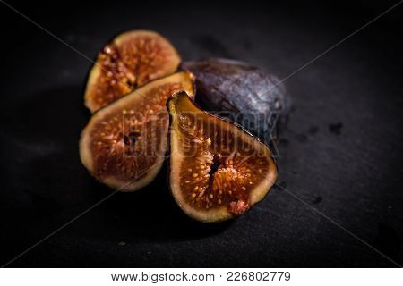 Figs Cut In Halves On A Dark Table
