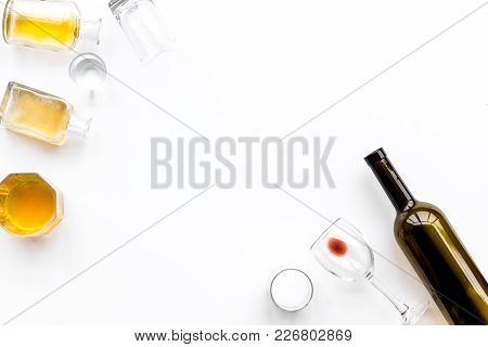 Alcohol Abuse. Drunkennes. Glasses And Bottles On White Background Top View.
