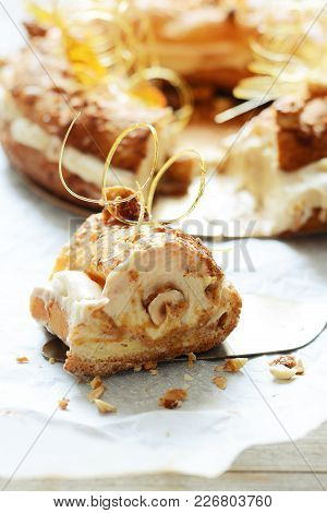 Cake Paris-brest From The Custard Batter With Air Custard, Praline And Nuts In Caramel. French Desse
