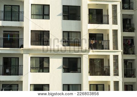 Several Windows In A Row On Facade Of Urban Apartment Building Front View In Hanoi, Vietnam