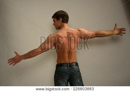The Sexy Hot Guy Is Stretching His Arms Out.