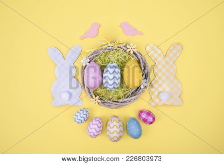 Creative Easter Composition With Painted Eggs On Yellow Background With Space For Your Text.
