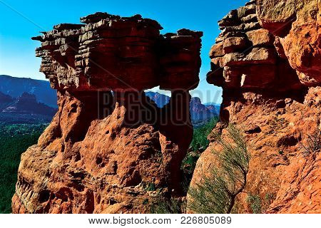 Columns Of Sandstone With Windows In Them Near The Top Of Brins Mesa In Sedona Arizona