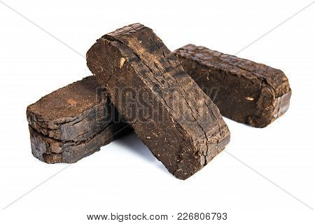 Peat Briquettes Isolated On White Background, Alternative Fuels, Raw Material