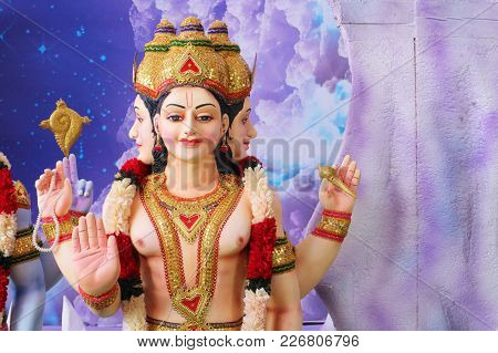 The Sculpture Of The Four-faced Lord Brahma. India, Tirupati, February 7, 2018.