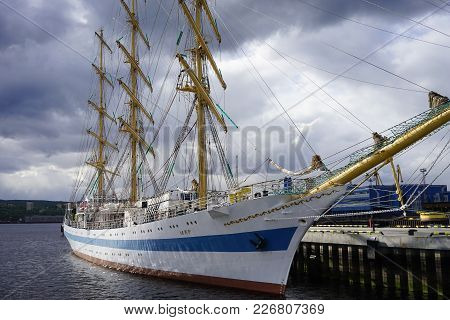 Murmansk, Russia-june 5, 2015: Sea Port In The Arctic Town With Moored Old Sailing Ship.
