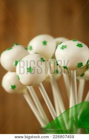 White Chocolate Cake Pops With Green Stars. Treat For St Patrick`s Day