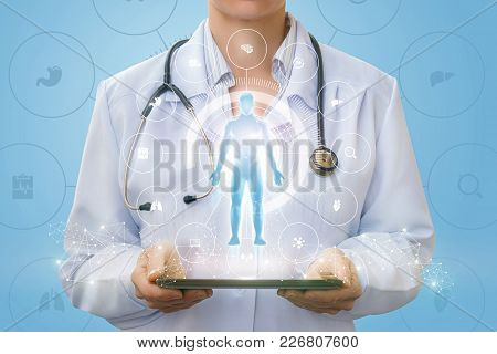 Doctor On The Tablet Shows A Hologram Of A Man And Icons Bodies.