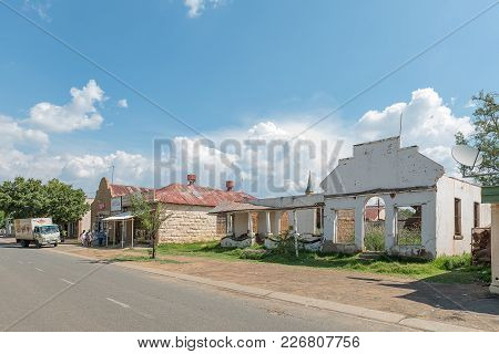 Excelsior, South Africa, February 9, 2018: A Street Scene, With Supermarket And A Ruin, In Excelsior