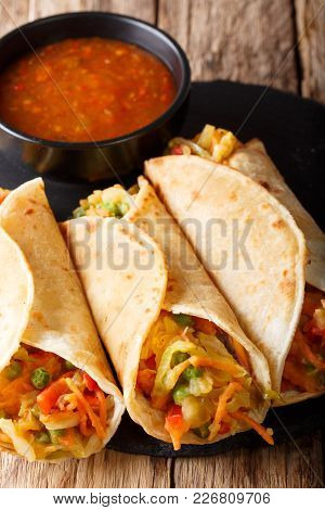 Indian Food Frankies: Roti Roll Stuffed With Vegetables Close-up. Vertical
