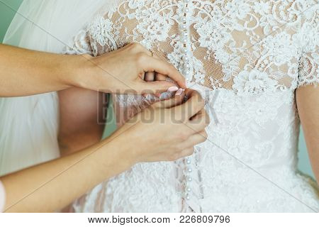 The Friend-witness Of The Bride Helps To Dress Bridal Dress Bride