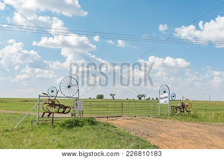 Entrance Gate To A Farm On The R709 Road Near Excelsior, A Small Town In The Free Strate Province Of