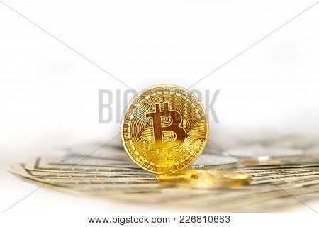 Several Gold And Silver Coins Of Bitcoin On Dollar Bills As A Symbol Of A New Currency