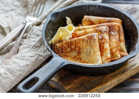 Crepes With Butter And Powdered Sugar.