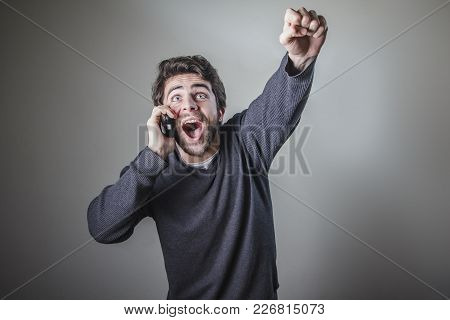 Good News, Young Man Receiving Great News Over Hiss Cell Phone