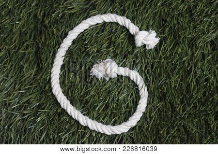 Rope Latin Alphabet On Grass. Letter G