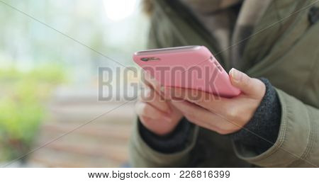 Body part of woman use with mobile phone