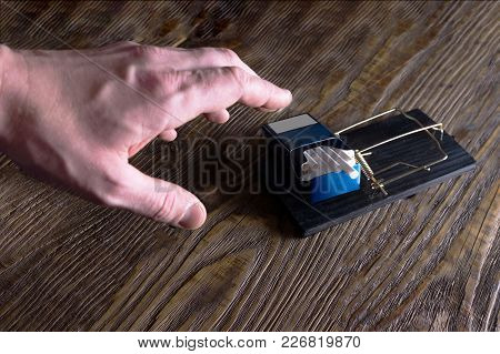 Hand Reaching For A Cigarette In Mousetrap. Copy Paste