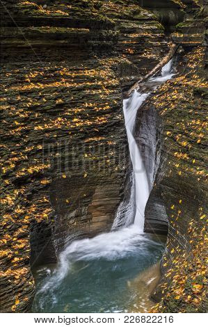 Pluto Falls, A Narrow, Curving Waterfall In The Glen Arcadia Section Of Watkins Glen, Splashes Into