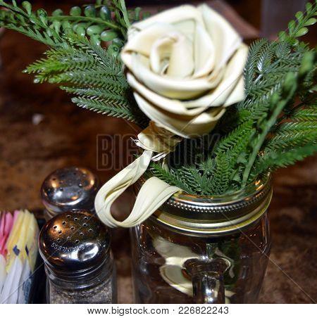 Close Up Sweet Grass Flower Centerpiece On Restaurant Table