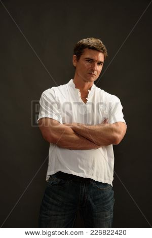 The Sexy Man Is Folding His Arms.