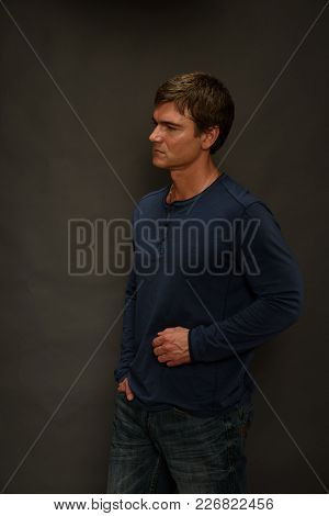 The Handsome Man Is Dressed In A Nice Blue Shirt